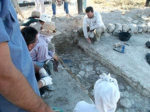 Gathering Around Foundation Trench - (Photo by Douglas Clark)