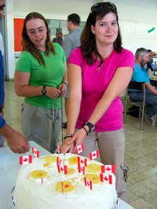 Barbara van Vierssen Trip and Erin Carr from Calgary at the Canada Day cake (photo by Katie Van Petten)