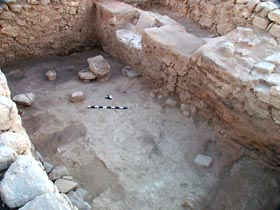 Large hall of the Late Bronze Age palace/temple with wall of mixed construction of bricks and stones on right