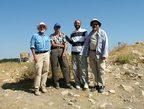 Doug Clark and Larry Herr surrounding Adeib Abu-Schmays and Jihad Haroun of the Department of Antiquities